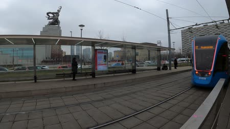 fare : MOSCOW, RUSSIA - NOVEMBER 27, 2019: Tram rides by rails during cloudy day. VDNKh station.