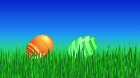 easter : Animated colorful rolling eggs in green grass. Loop footage for Easter. Holiday template in video format 4K