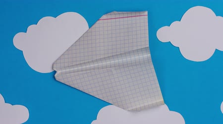 origami : Paper airplanes flying over a sky with clouds and takeoff. Stop motion animation. 4k