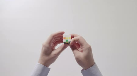 deha : Businessmans hands solving rubiks cube puzzle. Puzzle cube, puzzle game, best-selling toys.