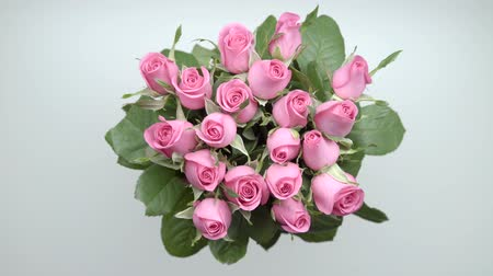 darling : Hands of women taking bouquet of pink roses and presents from the table. 25