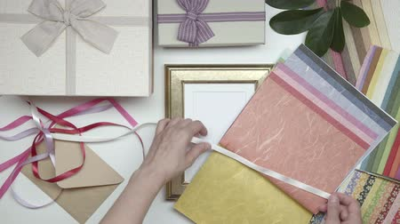 part of the frame : Wrapping photo frame as gift. 09. Part 03. Stock Footage