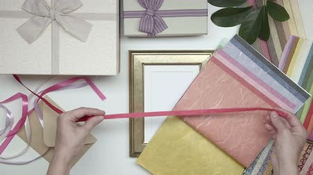 открытка : Wrapping photo frame as gift. 12. Стоковые видеозаписи