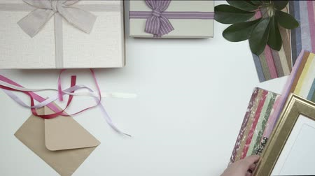 wrapping paper : Wrapping photo frame as gift. 15. Part 01. Stock Footage