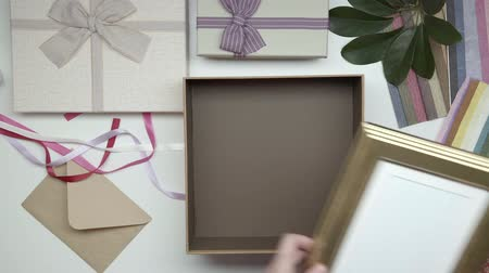 wrapping paper : Wrapping photo frame as gift. Speed up. 21. Stock Footage