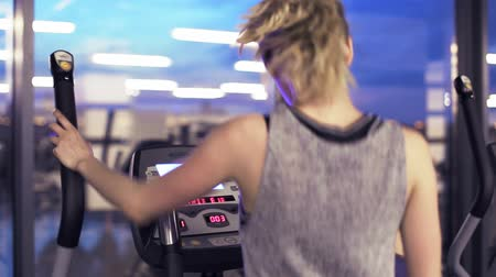 elliptical : Workout on elliptical trainer in the evening gym