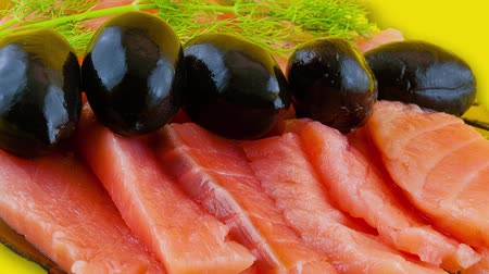 preparado : red salt fish and black olives are on a small platter Stock Footage