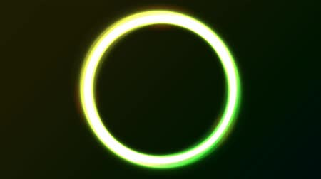 göz kamaştırıcı : Abstract Green Eclipse Light Circles Animation Animation of a loop of abstract shiny green neon light of sloar eclipse with bright effect on black background