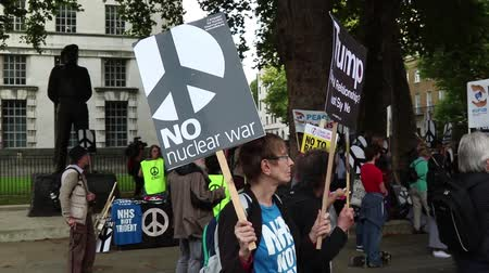 dprk : London, 28th September 2017:- Protesters gather in Whitehall, opposite Downing Street, to protest the growing tensions between North Korea and the USA Stock Footage