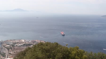 iberian : Gibraltar, United Kingdom, 1st October 2018:- Europa Point, seen from the Rock of Gibraltar. Gibraltar is a British Overseas Territory located on the southern tip of Spain. Stock Footage