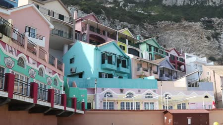 iberian : Gibraltar, United Kingdom, 2nd October 2018:- Colourful buildings along the seafront in Catalan Bay, Gibraltar. Gibraltar is a British Overseas Territory located on the southern tip of Spain. Stock Footage