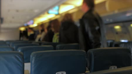 selektif : v1. Passengers disembarking from airplane using a tilt shift lens. Stok Video