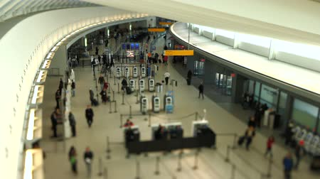 selektif : v22. Airport travelers at checkin area using a tilt shift lens.