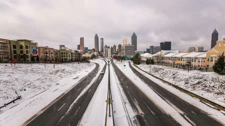 ga : v7. Atlanta cityscape time lapse after rare snow storm.