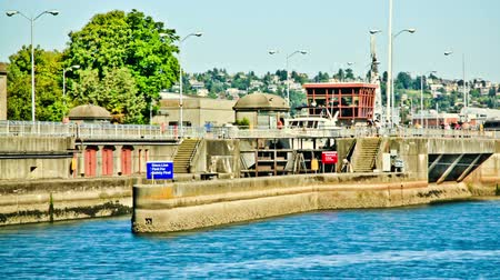 személyszállító hajó : v1. Ballard Locks time lapse clip using a luminance photo effect. Stock mozgókép