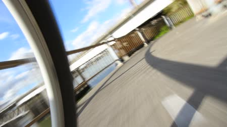 sportowiec : v4. Low angle view shot of riding a bicycle down to waterfront area. Camera attached to bike.