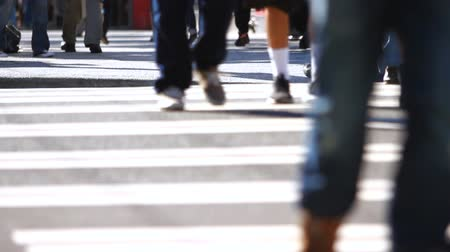 crosswalk : v16. Sequence shot of anonymous large crowds crossing the street. Foot traffic view. Stock Footage