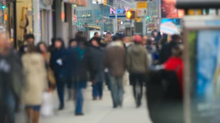 unrecognizable people : v1. Time lapse of anonymous large crowds walking by in the city and crossing streets.