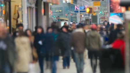 unrecognizable people : v2. Zooming time lapse of anonymous large crowds walking by in city & crossing streets.