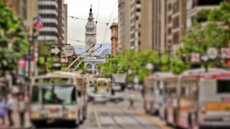 crowded : v13. City traffic time lapse using a unique photo and tilt shift effect. Clock tower in focus. Stock Footage