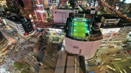 útkereszteződés : v91. Aerial city traffic time lapse of busy Shibuya Tokyo streets downtown at night.