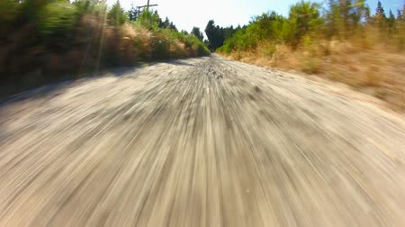 palce : v40. Country driving on gravel road using a fisheye lens 8 inches from ground.