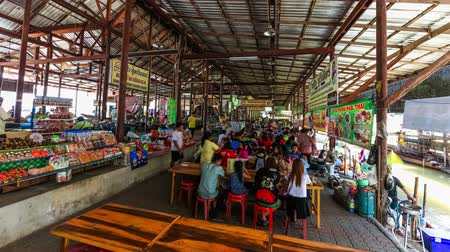 ratchaburi : Floating boat market time lapse in Damnoen Saduak, Thailand on February 9th 2014. Stock Footage