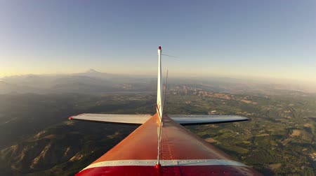 jet out : v1. Rear view flying time lapse clip out of Hood River and around Mt Hood. Stock Footage