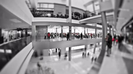 loja : Mall  time lapse in greyscale except red.
