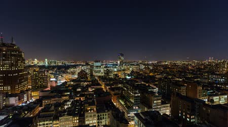 ночная жизнь : v15. NYC cityscape panning time lapse of downtown financial district over to uptown area at night.