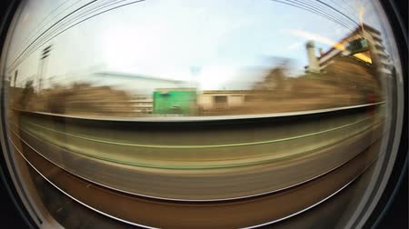 bok : v24. Passenger train time lapse through Tokyo using fisheye lens. Dostupné videozáznamy