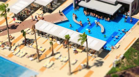 crowded : v2. Pool time lapse using a tilt shift lens.