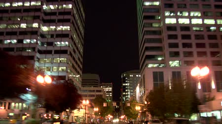 át : v23. Portland city driving time lapse at night rear view. Stock mozgókép