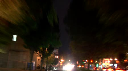 боке : v24. Portland city driving time lapse at night rear view.