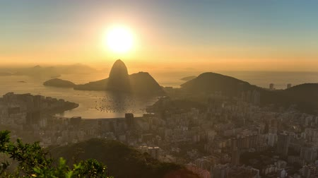 brezilya : v2. Rio De Janeiro zooming cityscape time lapse of sunrise over Sugar Loaf Mountain.