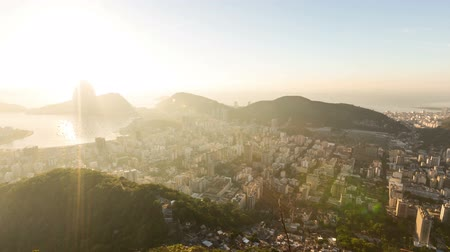 sugar loaf : v5. Rio De Janeiro panning cityscape time lapse of sunrise over Sugar Loaf Mountain.