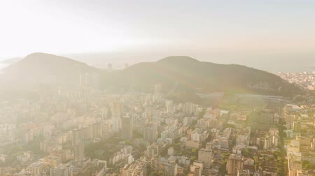 sugar loaf : v6. Rio De Janeiro panning cityscape time lapse of sunrise over Sugar Loaf Mountain.
