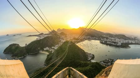 brazília : v9. Rio De Janeiro cityscape time lapse of sunset over Christ The Redeemer from Sugar Loaf Mountain.