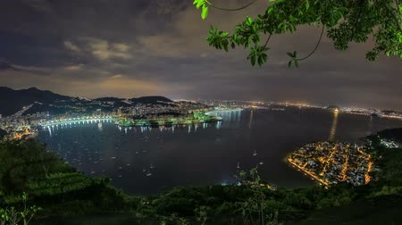 brezilya : v15. Rio De Janeiro cityscape panning time lapse at night from lower Sugar Loaf Mountain using HDR. Stok Video