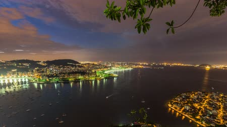 Рио : v18. Rio De Janeiro cityscape panning time lapse at night from lower Sugar Loaf Mountain using HDR. Стоковые видеозаписи