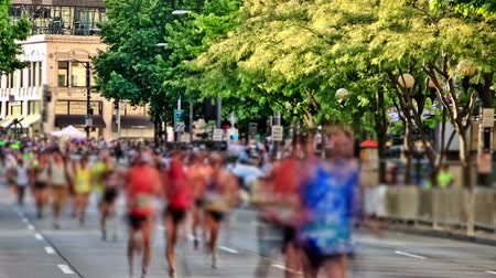 selektif : v2. Time lapse clip of marathon runners passing by using a photo effect.