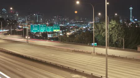 cauda : v7. Panning time lapse of I-5 freeway with Space Needle and cityscape in the background. Stock Footage