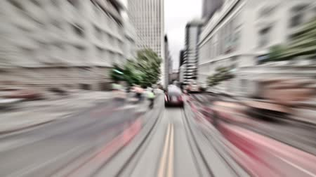át : v3. San Francisco city driving time lapse down California Street using a photo and zoom blur effects.
