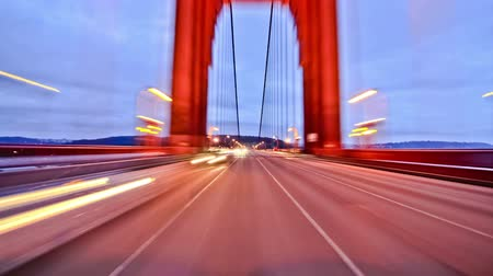 át : v6. San Francisco city driving time lapse over Golden Gate bridge and using a photo effect.