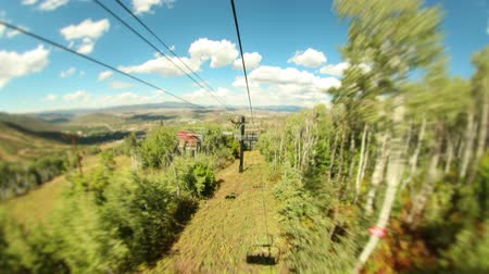 lombhullató : v17. Ski lift ride time lapse down mountain in the summer using a tilt shift effect.