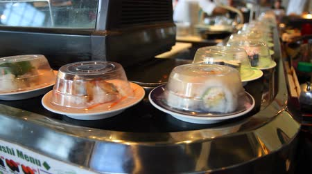 preparado : v3. Sushi going past on conveyer belt. Stock Footage
