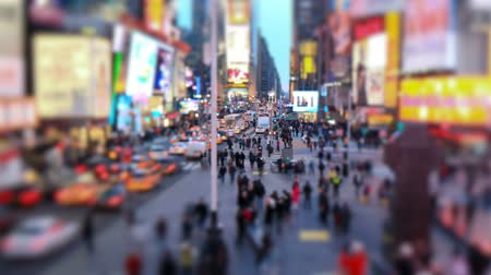 város : v3. Busy city traffic time lapse of TImes Square, tilt shift and circular blur. Stock mozgókép