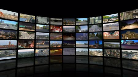 filmes : v26. Video wall of HD transportation videos. Zooming out to reveal full video wall.
