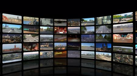 chaves : v28. Video wall of HD transportation videos. Zooming and panning out to reveal full video wall.