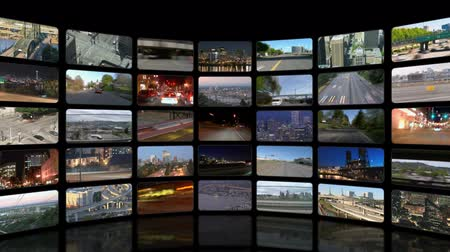 parede : v30. Video wall of HD transportation videos. Zooming out to reveal full video wall.